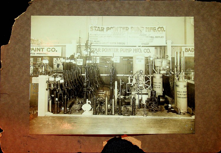 [ Photograph ] Photograph of a trade show booth for Star Pointer Pump Mfg. Co. of Menasha Wisconsin circa 1900. Star Pointer Pump Mfg. Co.