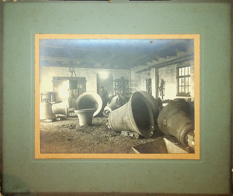 [ Photography, Industrial ] Silver print of a Bell foundry showing eight very large bells.