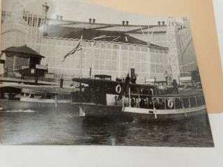 Boats in front of Machinery Hall at the 1897 Stockholm Exhibition [ descriptive title by seller ]